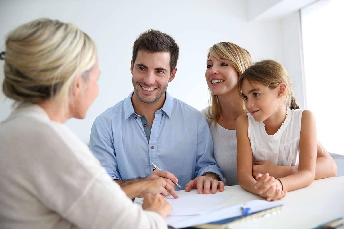 Family meeting real estate agent for their first home purchase.
